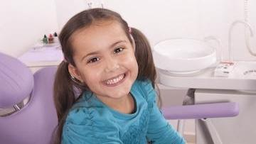 Young girl with pigtails smiling l Children's dentist Kalaheo HI